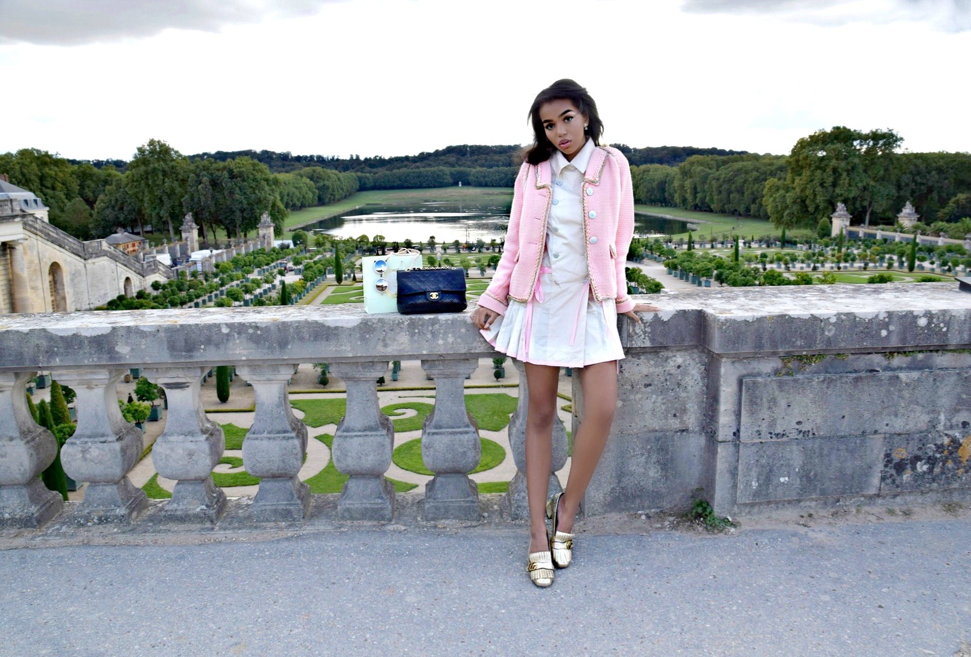 Welcome To Versailles // Paris France Travel Diary // Pink Chanel Tweed Jacket // Chanel Pink and Beige Pleated Dress // Gold Gucci Loafers // Chanel Black Classic Flap Bag // Pearl Round Chanel Sunglasses // Los Angeles Fashion Blogger Daphne Blunt: To Style, With Love