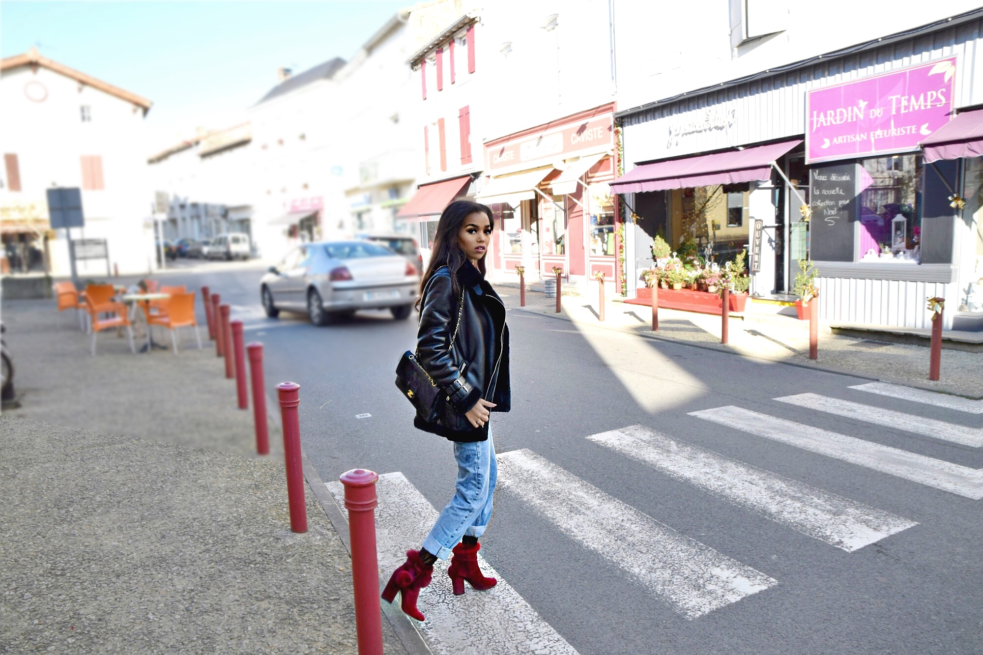 The French Market // Re Done High Rise Jeans // Are You Am I Bodysuit // Acne Studios Shearling Coat // M Gemi Red Fur Ball Booties // Zara Choker // Chanel Classic Black Flap Bag // The Charente Region Of France // France Travel Diary // Los Angeles Fashion Blogger Daphne Blunt: To Style, With Love