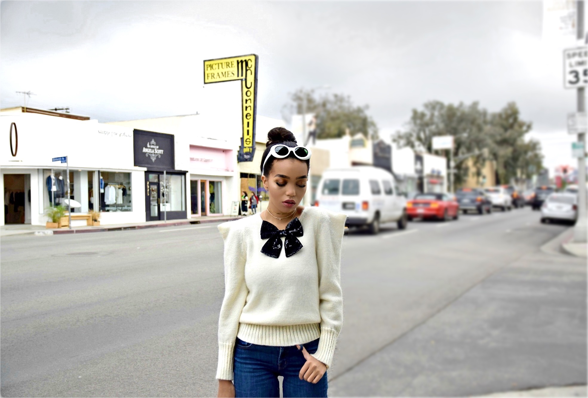 All YSL Everything // Saint Laurent Street Style // Saint Laurent White Sweater with Pointed Shoulders and A Black Sequin Bow // Saint Laurent Bomber Jacket // Saint Laurent Red & Gold Cowboy Booties // Louis Vuitton Mini Backpack // Are You Am I Gold Choker // J Brand Jeans // Acne Studios Mustang Sunglasses // Los Angeles Street Style Fashion Blogger Daphne Blunt: To Style, With Love