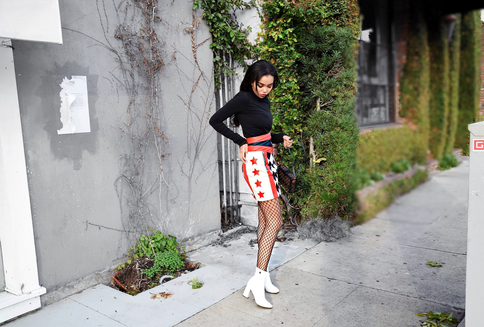 Start Your Engines // ASOS Checker Print Star Red & Black Leather Mini Skirt High Waisted // Black Theory Turtleneck // ASOS Fishnet Tights // Louis Vuitton Monogram Classic Petite Malle // Public Desire White Patent Leather Booties // Los Angeles Fashion Blogger Daphne Blunt // Winter + Spring Personal Street Style Look: To Style, With Love