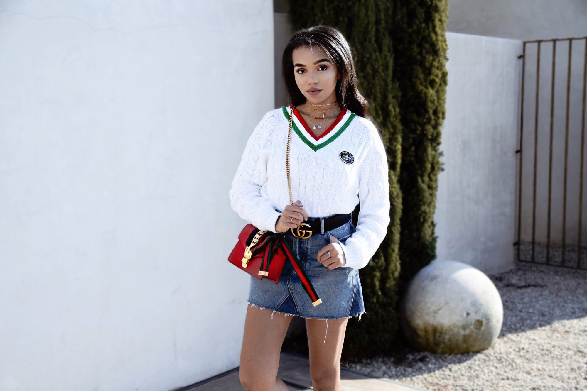 Supreme x Lacoste // Varsity Sweater Red and Green // GRLFRND Denim Mini Skirt // Gucci GG Marmont Belt // Gucci Spike Sneakers // Gucci Red Crossbody Bag // Los Angeles Fashion Blogger Daphne Blunt: To Style, With Love